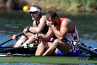 Silver medalist Damir Martin, of Croatia, right, reacts as gold medalist Mahe Drysdale, of New Zealand, rests after the men's rowing single sculls final. Photo / AP.