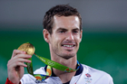 Andy Murray smiles as he holds up his gold medal at the 2016 Summer Olympics in Rio. Photo / AP