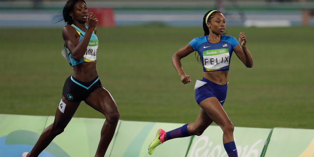 United States' Allyson Felix (r) in the women's 400-metre semifinal earlier today. Sky TV sought a court injunction to stop Fairfax Media using video footage on its new website. Photo / AP