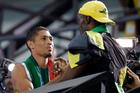 Jamaica's Usain Bolt, gold medal winner in the men's 100-meter, shakes hands with South Africa's Wayde Van Niekerk, gold medallist for the men's 400-meter. Photo / AP.