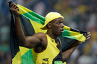 Jamaica's Usain Bolt celebrates after winning gold in the men's 100-metre final. Photo / AP