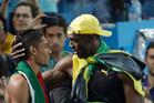Usain Bolt wants to race 400m winner Wayde Van Niekerk. Photo / Julio Cortez
