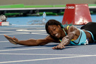 Bahamas' Shaunae Miller falls over the finish line to win gold in the women's 400-metre final. Photo / AP