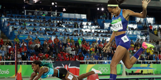 Loading Bahamas' Shaunae Miller falls over the finish line to win gold ahead of United States' Allyson Felix, right, in the women's 400-meter final. Photo / AP.