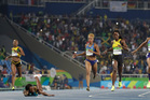 Bahamas' Shaunae Miller, second left, beats United States' Allyson Felix, second right, to win the women's 400-meter final during the athletics competitions. Photo / AP.
