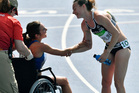 New Zealand's Nikki Hamblin handshakes United States' Abbey D'Agostino, left, as she is helped from the track after competing in a women's 5000-meter heat at Rio Olympics. Photo / AP
