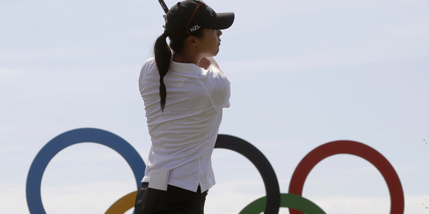 Lydia Ko watches her tee shot on the 17th hole during a practice round for the women's golf event. Photo / AP