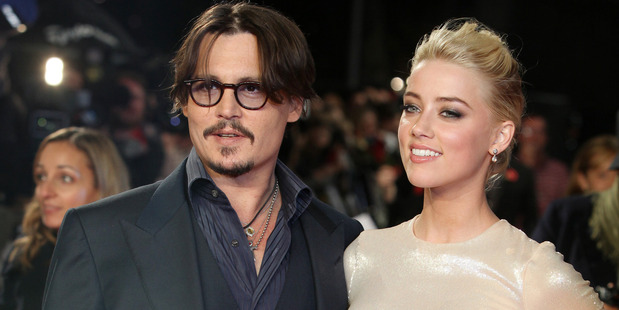 Amber Heard filed for divorce in May and days later obtained a temporary restraining order against Johnny Depp. Photo / AP