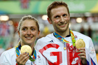Laura Trott, left, and her fiance Jason Kenny, right, both of Britain, pose with their gold medals. Photo / AP