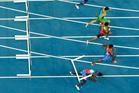 Haiti's Jeffrey Julmis falls down after hitting a hurdle in the 110m semifinals. Photo / AP