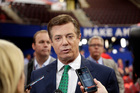 Trump Campaign Chairman Paul Manafort talks to reporters on the floor of the Republican National Convention. Photo / AP