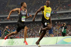 Canada's Andre De Grasse, left, and Jamaica's Usain Bolt during the men's 200-meter semifinal. Photo / AP