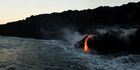 When the lava makes contact with the ocean, it reacts with the saltwater and produces harmful hydrochloric acid, which wafts into the air. Photo / AP