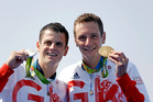Gold medalist Britain's Alistair Brownlee, right, stands with his brother, silver medalist Jonathan Brownlee, after they finished first and second in the men's triathlon. Photo / AP