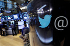 The Twitter logo appears on a phone post on the floor of the New York Stock Exchange. Twitter said it had suspended 360,000 accounts. Photo / AP