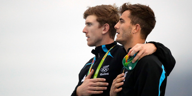 New Zealand's Blair Tuke, right, and teammate Peter Burling celebrate their gold medal win in the 49er class. Photo / AP