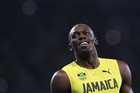 Usain Bolt from Jamaica celebrates after crossing the line to win the gold medal in the men's 200-meter final during the athletics competitions. Photo / AP.