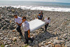 Six replicas of this wing fragment found on Reunion Island in July last year, will be  released into the ocean. Photo / AP
