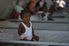 A girl receives treatment for cholera symptoms at a Doctors Without Borders, MSF, cholera clinic in Haiti. Photo / AP