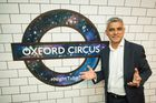 Mayor of London Sadiq Khan poses in front of a new Night Tube logo at Oxford Circus underground station. Photo / AP