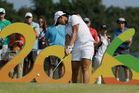 Lydia Ko of New Zealand tees off on the 16th hole during the third round of the women's golf event. Photo / AP