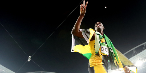 Usain Bolt celebrates winning the gold medal in the men's 4x100-meter relay. Photo / AP