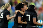 New Zealand's Portia Woodman, middle, with teammates reacts emotionally after loosing the women's rugby sevens gold medal match against Australia at the Summer Olympics. Photo / AP