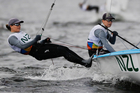 New Zealand's Polly Powrie, left, and Jo Aleh compete during the 470 women race at the 2016 Summer Olympics in Rio. Photo / AP