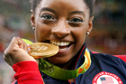 Simone Biles of the United States poses with her
