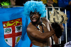 A Fiji fan celebrates his country's gold medal victory over Britain. Photo / AP