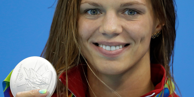 Efimova shows off her silver medal for the women's 200m breastroke final. Photo / AP