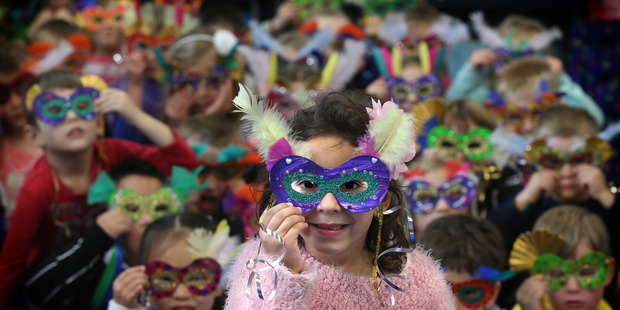 Mount Maunganui Primary students have made Brazilian masks for different countries for the Rio Olympics. Photo/John Borren