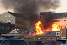 Fire destroyed a large, unoccupied building in Sol Square, Christchurch in July. Photo / Newstalk ZB