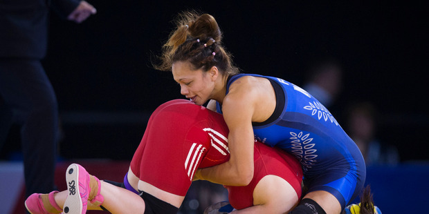 TOP CLASS: Mount Maunganui wrestler Tayla Ford, blue, in action at the Commonwealth Games in Glasgow. PHOTO/SUPPLIED A_300714NZHGBGLASGOW844