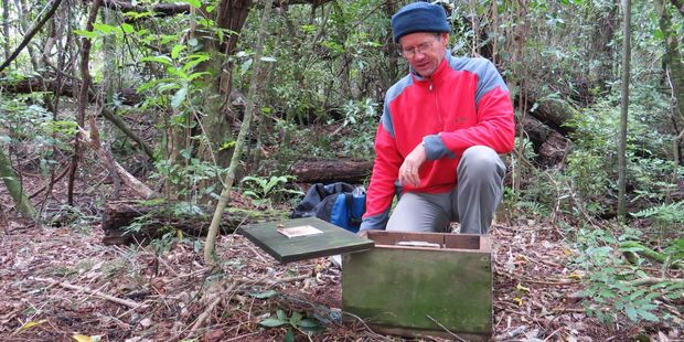 CHB Forest and Bird member Peter Meredith checks one of the predator traps as part of the ongoing maintenance of Lindsay Bush.
