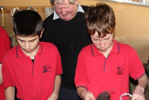 Norsewood and Districts School student Jimi Shotter, left, with Wimbledon farmer Brian Hales and fellow student Harvey Trent learning the techniques for making their own felted slippers. Photo / Christine McKay