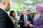 Health Minister Peseta Sam Lotu-Iiga talks to dairy owner Jarnail Singh. Photo / Warren Buckland