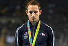 Silver medalist Renaud Lavillenie reacts during the medal ceremony for the men's pole vault. Photo / Getty