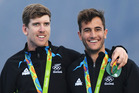 Peter Burling and Blair Tuke celebrate after winning the gold medal in the Men's 49er class at the Marina da Gloria. PHOTO/MATTHIAS HANGST