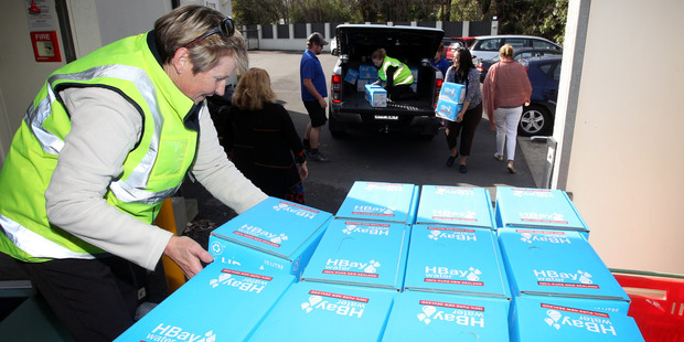 Loading Jo Haynes helps deliver bottled water to Duart Rest home in Havelock North yesterday. Photo / Paul Taylor
