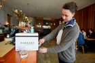 Wright & Co cafe director Liv Reynolds partakes of safe, bottled water while at work. Photo / Warren Buckland