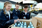 Havelock North High School students (from left)  Amy Culham, Sarah Birkett, both Year 9, and Blake Campbell, Year 10, get some  free water donated to the school yesterday by OnePure and Richard Lucas from Havelock North New World. Photo / Warren Buckland