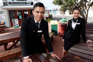 GROWTH: QRC Tai Tokerau Resort College students Giovani Ropati-Tongalea (left) and Kayla Brown in Paihia, the hub of Northland tourism, are among those who see a bright future in the industry.