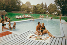 Guests enjoy the pool at Belvedere Manor. Photo / Getty Images