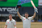 Shaun Marsh celebrates his century during what was the highest second-wicket stand for Australia in Tests against Sri Lanka with Steve Smith. Photo / AP