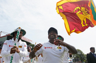 Sri Lankan bowler Rangana Herath, right, celebrates his side's series victory after taking match figures of 13-145 in the final test. Photo / AP