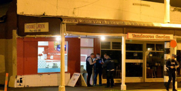 Police at the scene of the Tandooree Garden robbery, in St Kilda. Photo / Linda Robertson