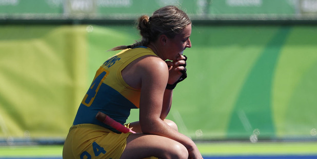 Australia's Mariah Williams pauses inside the pitch after her team lost to New Zealand. Photo / AP