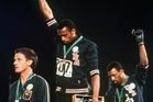 Tommie Smith, centre and John Carlos, right, at the Mexico Olympics 1968. Australian silver medallist Peter Norman is at left. Photo / AP