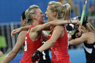 Britain's Alex Danson, left, celebrates her goal with her teammate Georgie Twigg, right, against New Zealand. Photo / AP